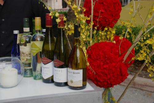 Coral Gables Wine and Food Festival bar decor, red carnations