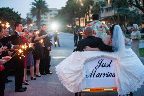 Just married couple on bicycle jitney, sparkler exit, Fort Lauderdale wedding