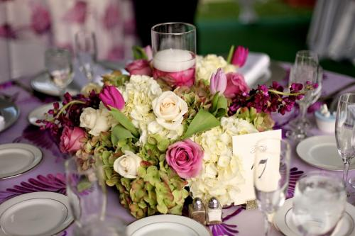 Pink and green roses and hydrangea wedding table centerpiece